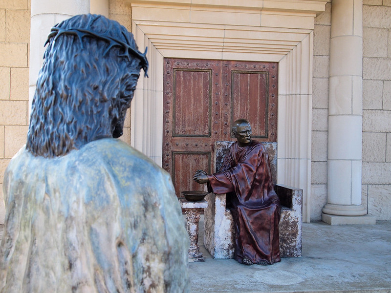 Statue of Jesus in front of Pilate washing his hands.