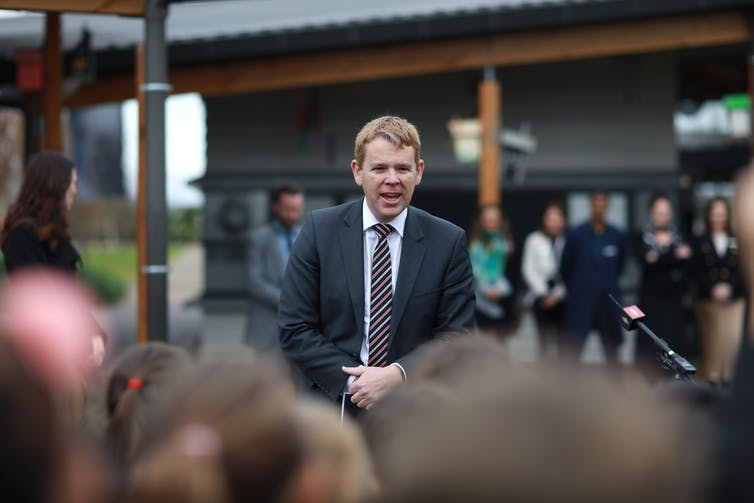 Education Minister Chris Hipkins speaking to a group of people