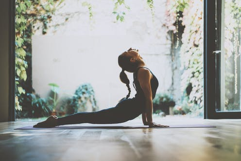 A woman in a yoga pose.