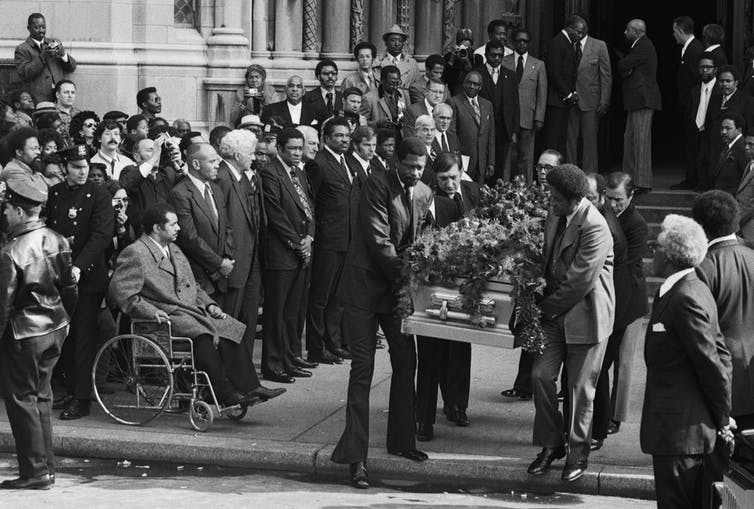 Jackie Robinson's casket being carried from a church.
