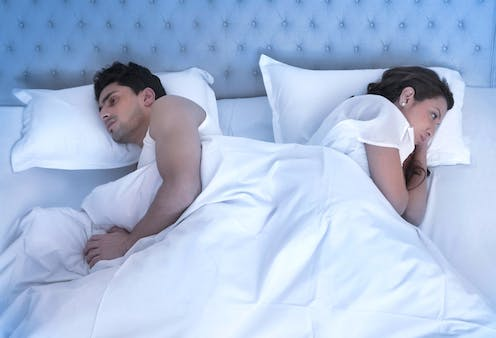 Unhappy straight couple in bed