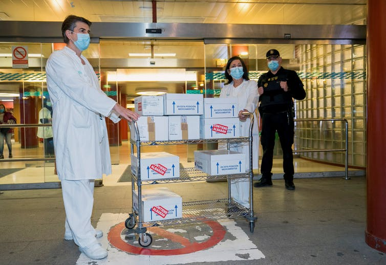 Health workers receive boxes of the AstraZeneca vaccine at University Clinico Hospital in Zaragoza, Spain.