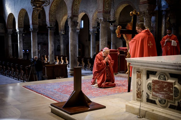The ceremony of the veneration of the cross, Cathedral of San Giusto, Italy.