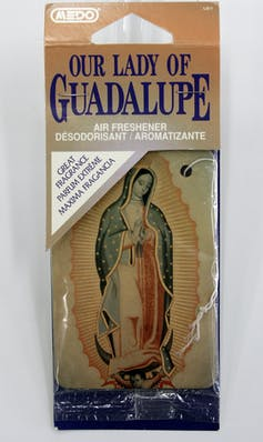 A Lady of Guadalupe car air freshener on display at the Marian Library