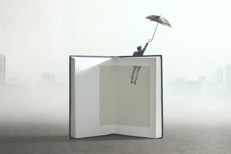 Illustration of an open book with blank pages and a male figure with an umbrella floating upwards out of the pages