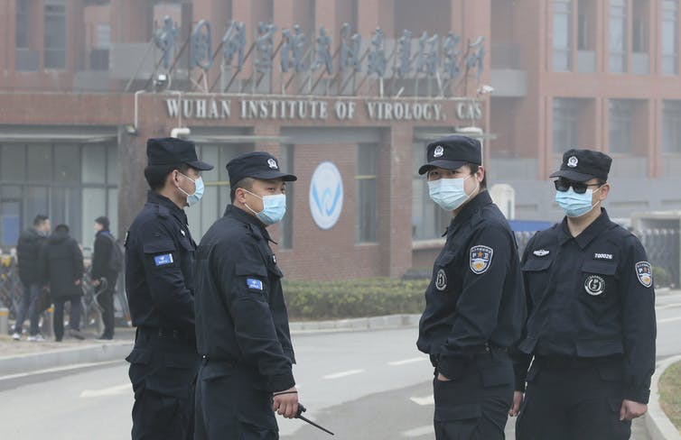 Masked security guards outside the Wuhan Institute of Virology