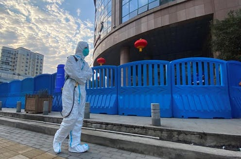 Man in full PPE in Wuhan, China