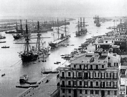 Shipping in the Suez canal at Port Said about 1880. The canal can be seen stretching southwards from this north entrance.