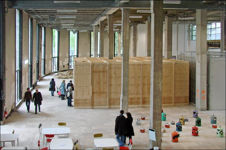 An interior shot from above of exhibition spaces in the Palais de Tokyo contemporary art gallery, in Paris