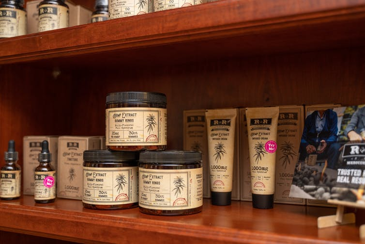 Wood shelf with various CBD products from the R+R Medicinals label on it