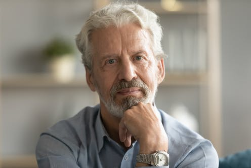 Middle-aged white man looking thoughtful