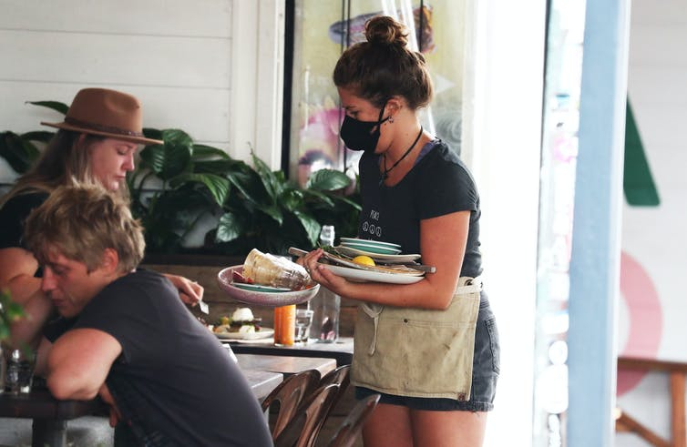 People eat at a cafe in Byron Bay.