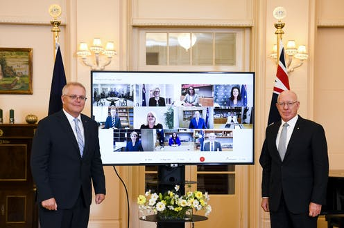 Scott Morrison and Governor-General David Hurley stand in front of a screen, displaying Morrison's newly appointed cabinet
