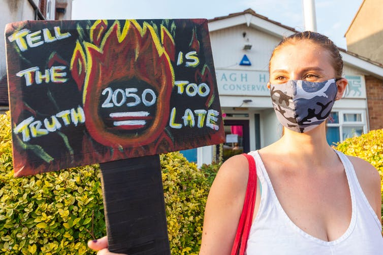 Banner reads 'Tell the truth 2050 is too late'.