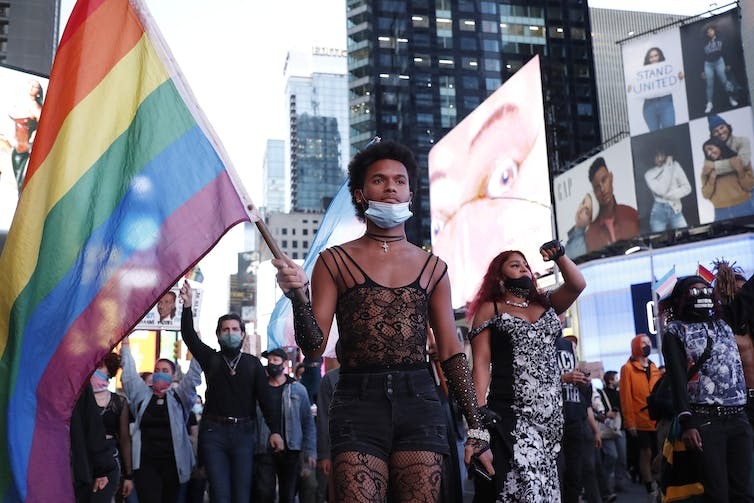 Protester holds rainbow flag during demonstration in Times Square in New York City