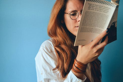Woman sitting reading a book
