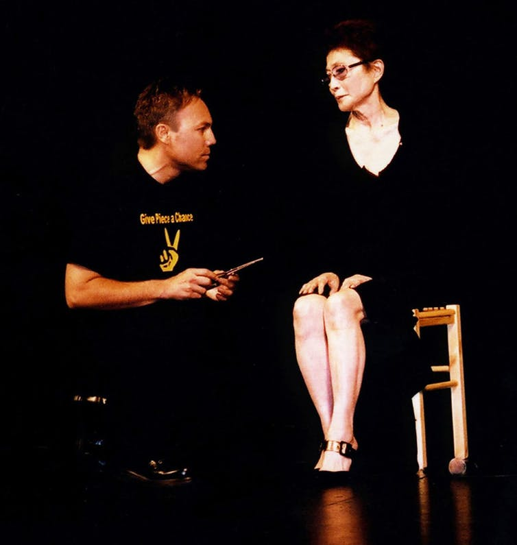 Yoko Ono and audience member onstage.