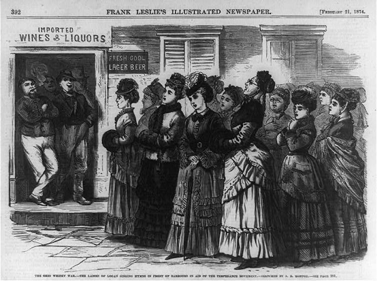 A woodcut illustration of a group of women outside a bar, where two men lean against the doorway