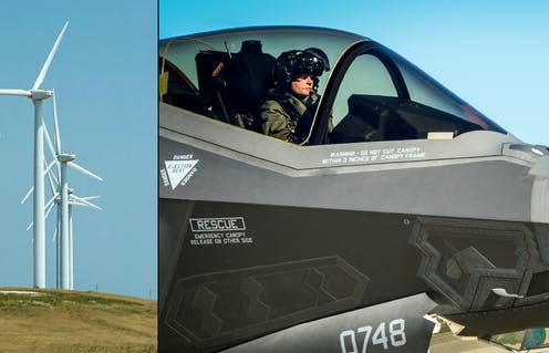 Images of wind turbines on a hill and a fighter pilot in an F-22A