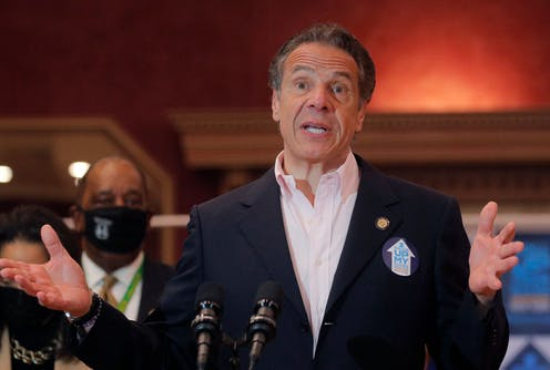 New York Gov. Andrew Cuomo speaking and gesticulating with his hands at a public gathering