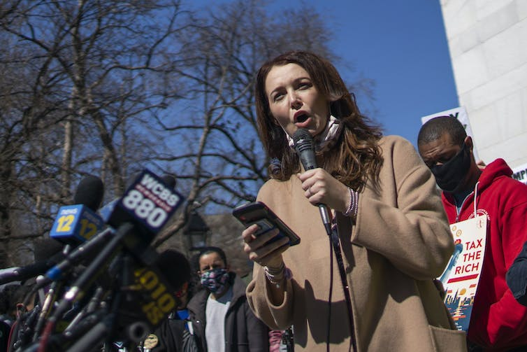 A woman who has accused Cuomo of sexual harassment speaks at a public gathering in New York City.