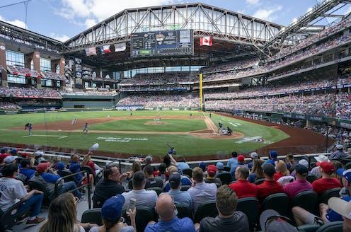 Fans filling the Rangers baseball stadium
