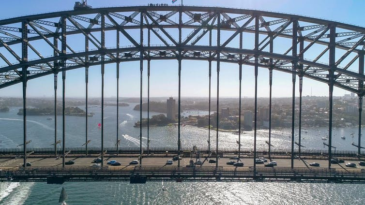 cars driving across Sydney Harbour Bridge