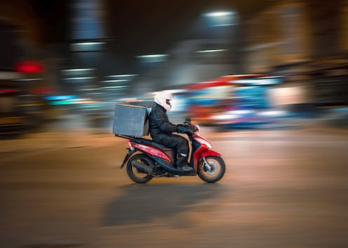 Food delivery man on scooter