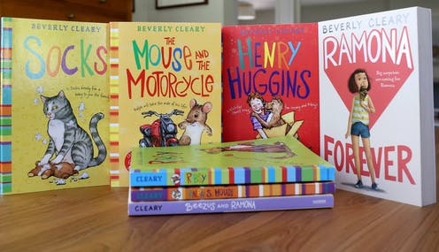 Four colorful Beverly Cleary children's books displayed upright behind a pile of three other Cleary books
