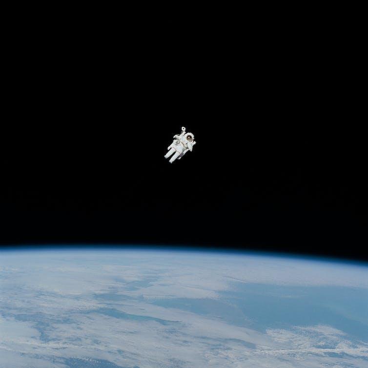 Astronaut in spacesuit floating