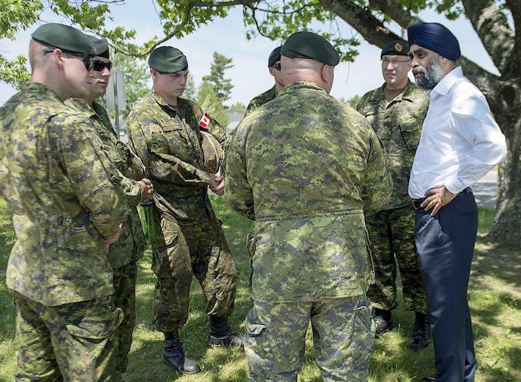 Men in uniform stand in a circle