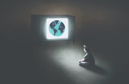 Illustration of a child sitting on the floor in the dark, watching a TV set that has the world on it