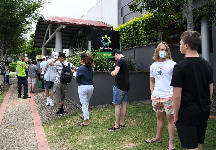 Newly unemployed queue at the Centrelink office in Southport on the Gold Coast, Queensland, March 23 2020.
