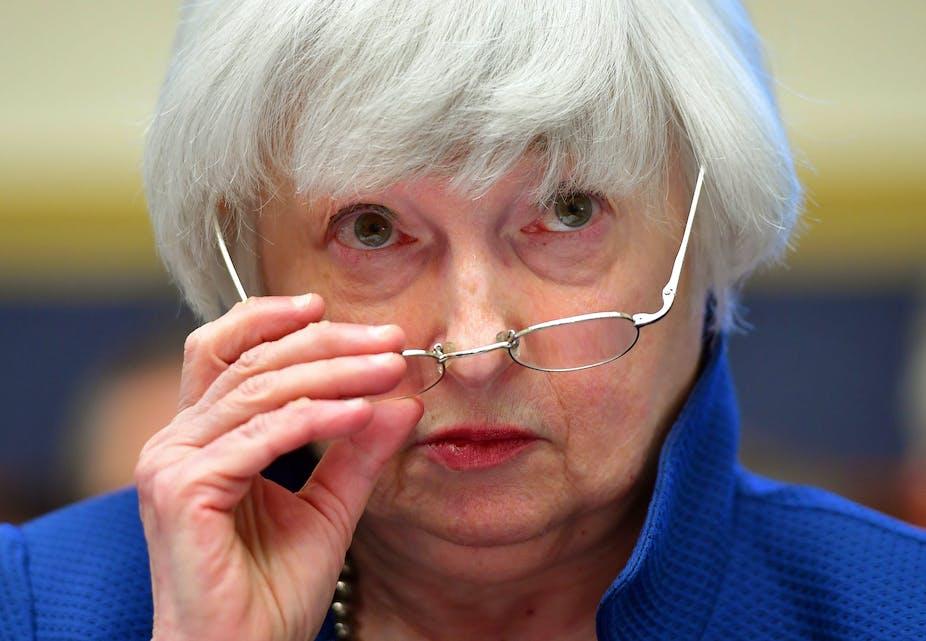 Janet Yellen adjusting her spectacles