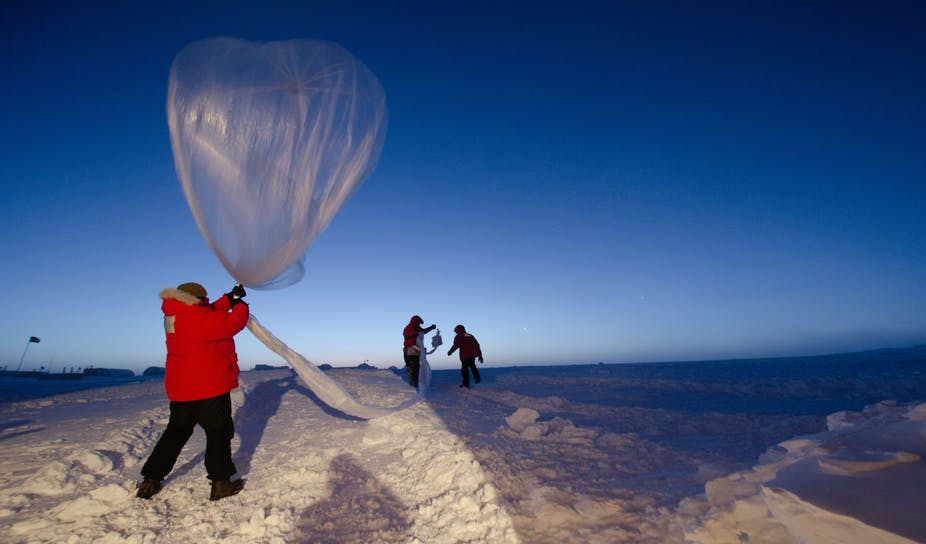 Scientists launch a balloon designed to measure ozone levels.