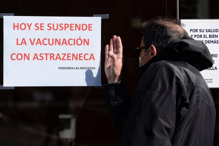 A man outside a closed AstraZeneca vaccination station in Spain.