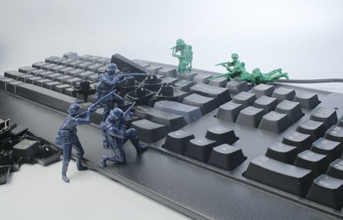 Toy soldiers fight over a computer keyboard
