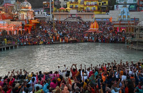 Hindu devotees attend evening prayers, in Haridwar, India. on the banks of the River Ganges