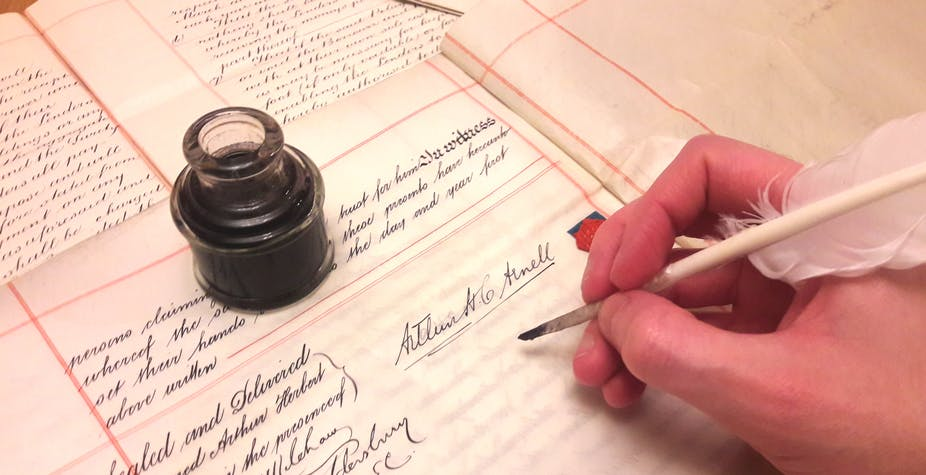 Signing a legal document with ink and quill.