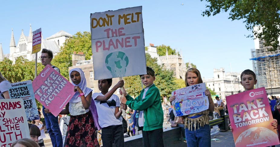 Children hold up posters at the 20th September 2019 climate strike in London