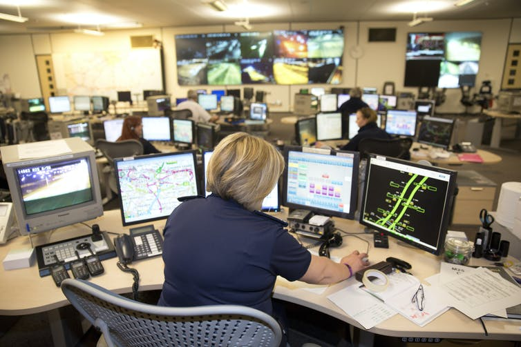An office full of computers depicting roads and traffic data.