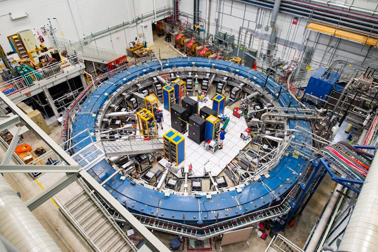 A large blue doughnut–shaped magnet used to measure muons.