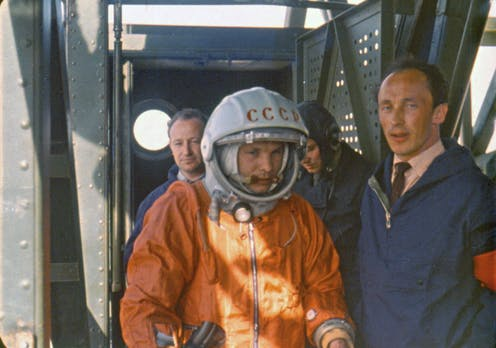 Rocket engineer Oleg Ivanovsky, right, leads Yuri Gagarin, center, to the Vostok spacecraft before the launch from what will later become known as the Baikonur cosmodrome.