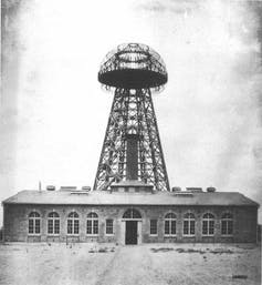 A black and white photo of an electricity tower