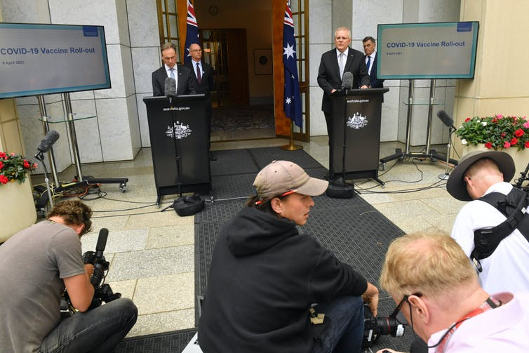 Prime Minister Scott Morrison, Health Minister Greg Hunt and health authorities at a Canberra press conference.