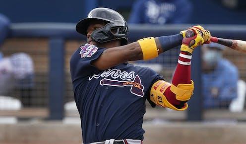 An Atlanta Braves named Ronald Acuna Jr. swings his bat during a spring training baseball game Port Charlotte, Florida.