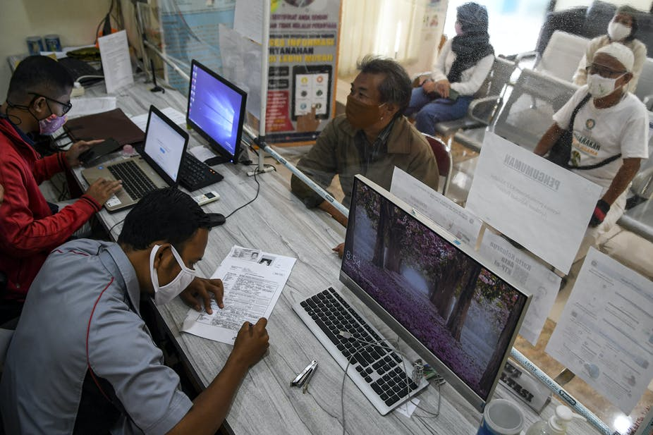 People at a civil registration office in Jakarta.