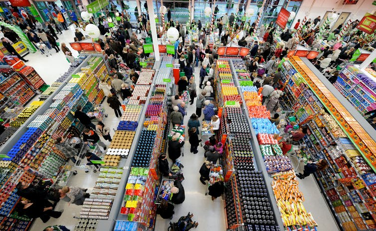 Overhead view of crowded aisles in supermarket