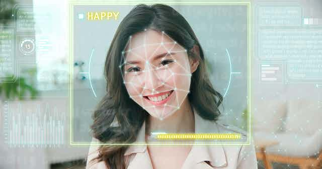 Image of a smiling woman being assessed by an AI.