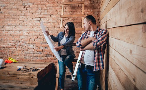 Man and woman looking at home plans